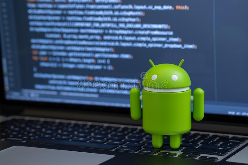 Google Android figure standing on laptop keyboard royalty free stock photos