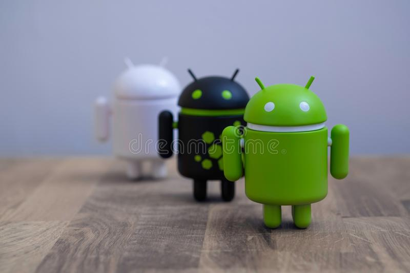 Google Android figures standing on desk stock photo