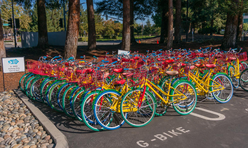 Google bikes in Google campus. MOUNTAIN VIEW, CA/USA - NOV, 2014: Exterior view of Googles Googleplex Corporate headquarters. Google is a multinational company royalty free stock image