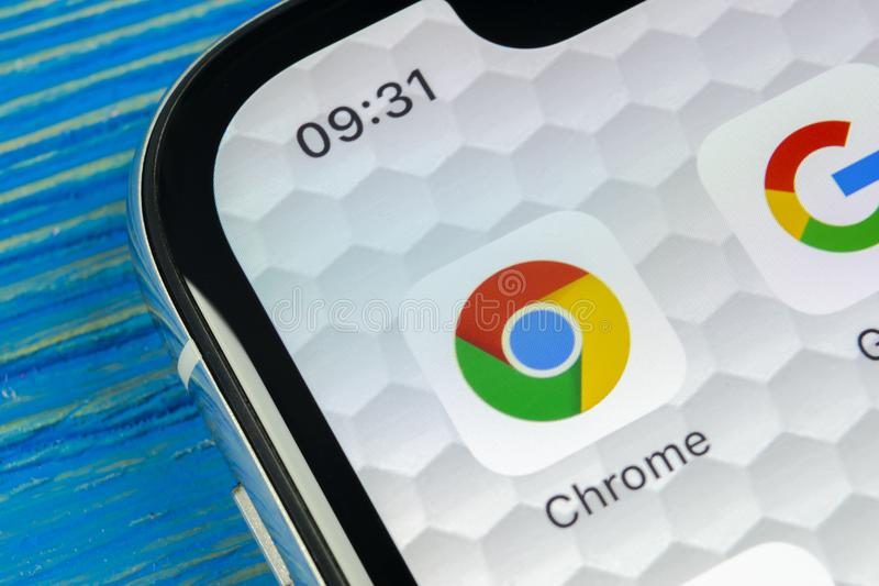 Google Chrome application icon on Apple iPhone X screen close-up. Google Chrome app icon. Google Chrome application. Social media. Sankt-Petersburg, Russia, June stock photography