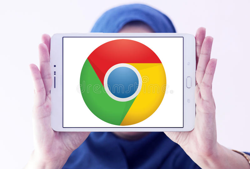 Google chrome web browser logo. Logo of google chrome web browser on samsung tablet holded by arab muslim woman stock photography