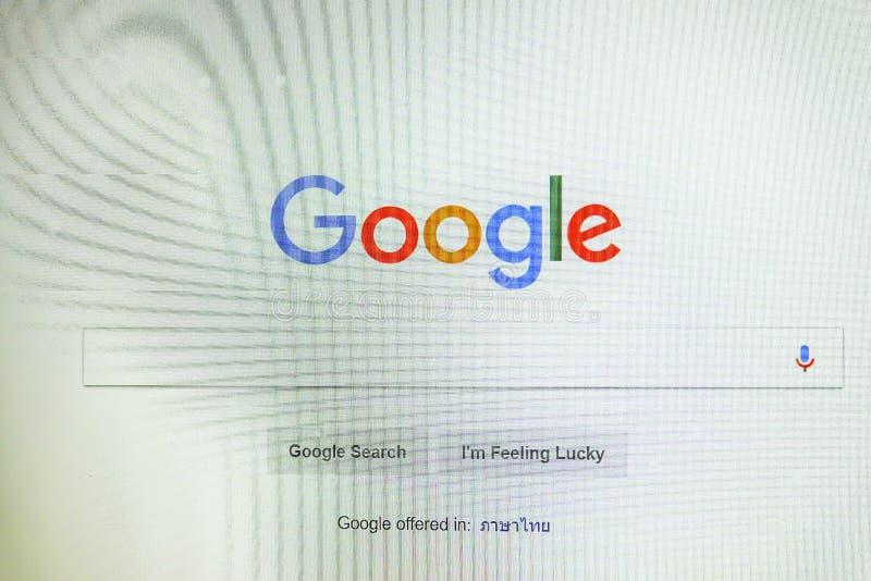 Google de homepage en de curseur van Com op laptop het scherm Google is wereld` s populairste zoekmachine stock afbeeldingen