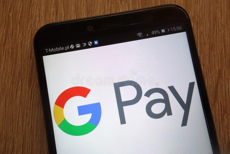 Google lönlogo som visas på en modern smartphone royaltyfri fotografi