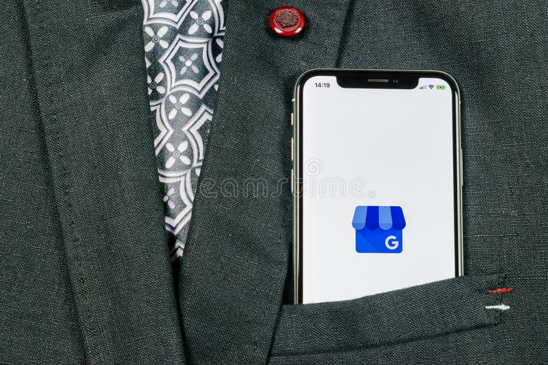 Google My Business application icon on Apple iPhone X screen close-up in jacket pocket. Google My Business icon. Google My busines. Sankt-Petersburg, Russia royalty free stock photos
