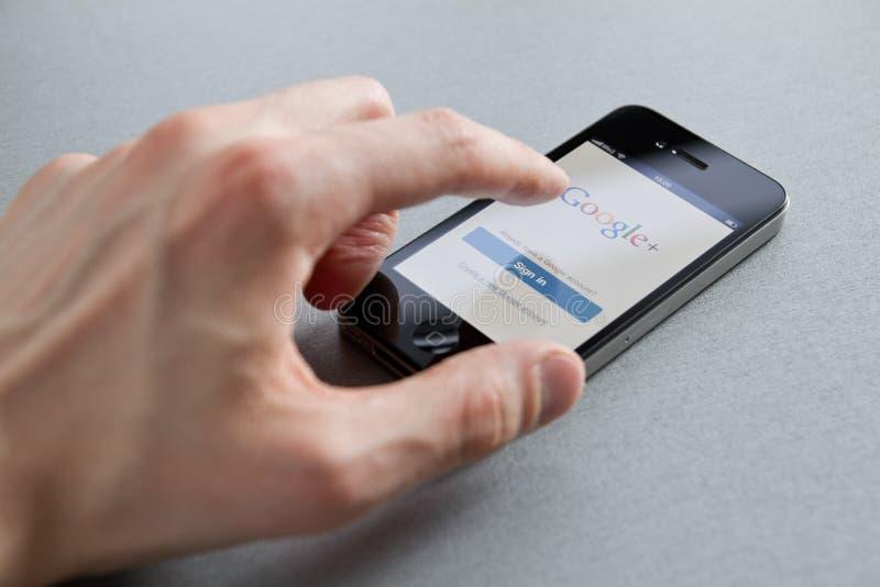 Google plus op iPhone van de Appel royalty-vrije stock foto's