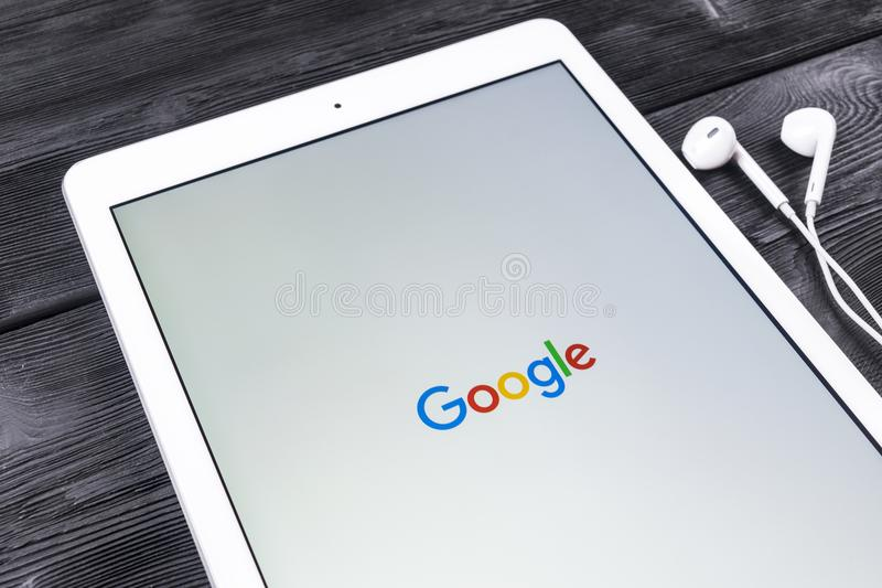 Google start web homepage page on display of Apple iPad Pro. Google is an American multinational corporation with Internet royalty free stock photos