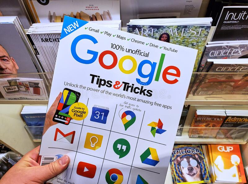 Google Tips and Tricks unofficial magazine with Google icons on the cover stock photos