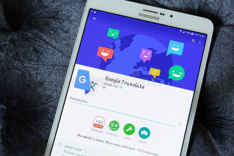 Google translate app. Downloading google translate application from google play store on samsung tab s2 royalty free stock photo