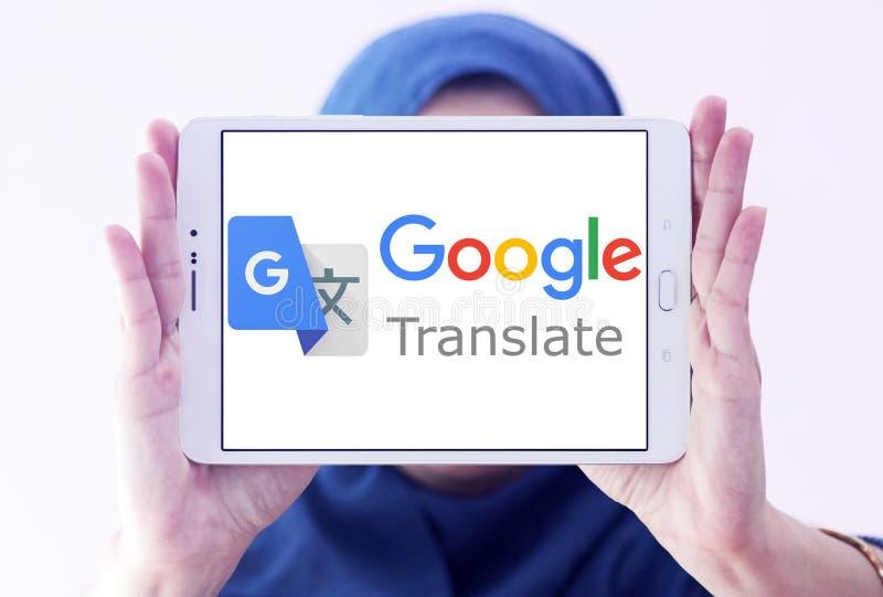 Google Translate logo. Logo of Google Translate on samsung tablet holded by arab muslim woman. Google Translate is a free multilingual machine translation stock photos