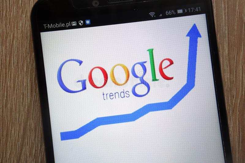 Google Trends logo displayed on a modern smartphone stock photo