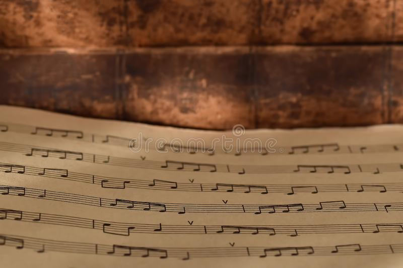 Goose feather and notes on the background of old books stock images