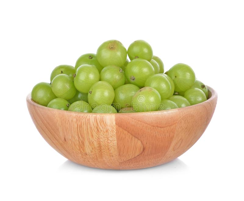 Gooseberries on Wooden cup isolated on white background. royalty free stock images