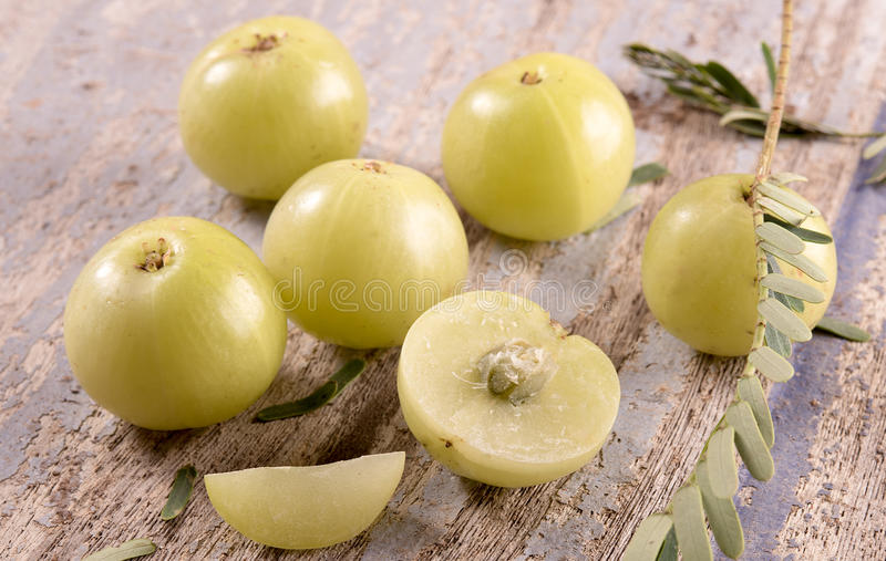 Gooseberry on wooden background stock images
