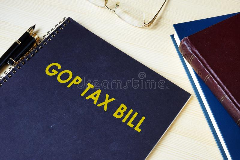 GOP Tax Bill on a desk. GOP Tax Bill on a desk and glasses stock image