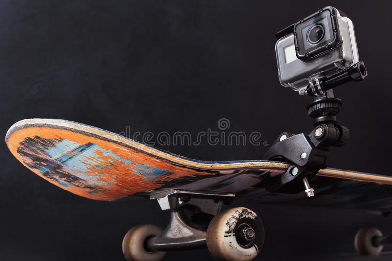 GoPro Hero5 fixed on professional skateboard stock images