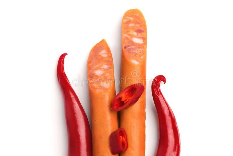 Gorący chili pieprze, kiełbasy dla smażyć odizolowywam na białym tle i fotografia royalty free
