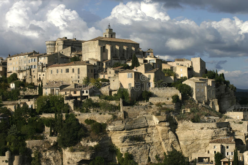 Gordes village in the Luberon, France under a moody sky. Gordes church and cliff face stock image