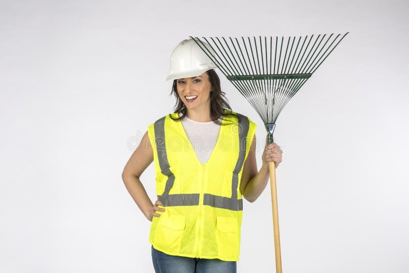 Gordo Trabajador De Construcción De Brunette Posando En Un Fondo Blanco imagenes de archivo