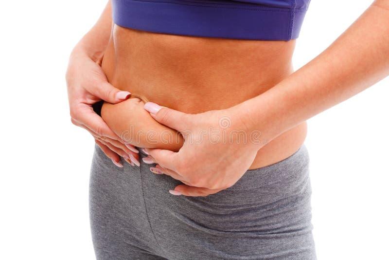 Gordura de medição da mulher nova foto de stock