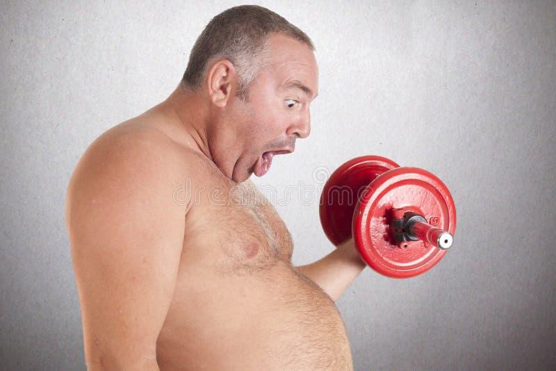 Gordura que joga esportes imagens de stock royalty free
