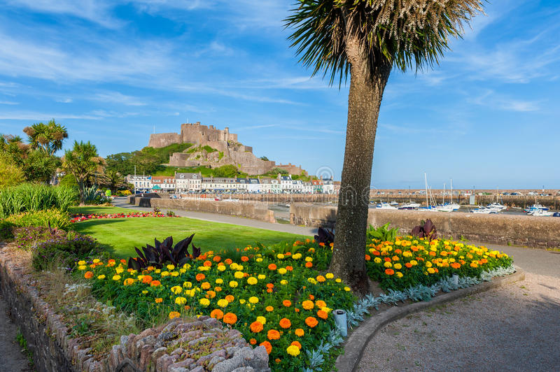 Gorey Castle in St Martin Jersey. Gorey Castle and Harbour of St Martin, Jersey, Channel Islands, UK at low tide stock photography