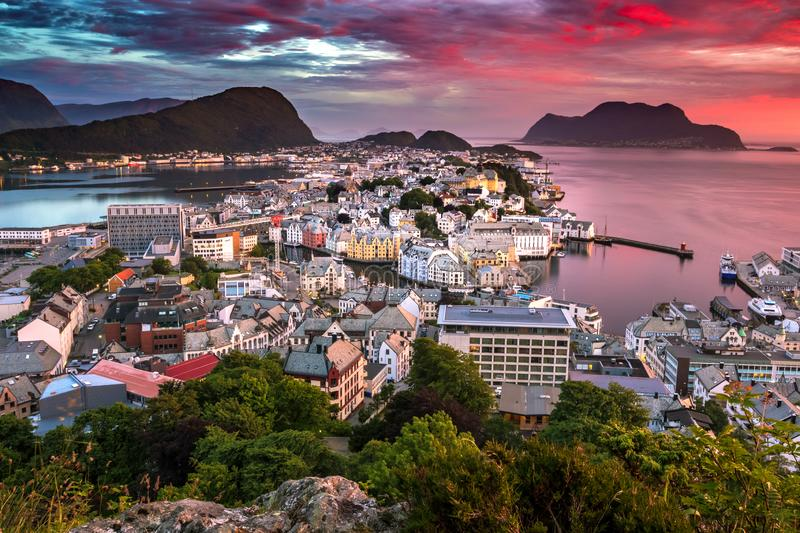 City Scene with Aerial View of Alesund Center at Gorgeous Sunset. Image of a perfect sunset in Alesund, the most beautiful town in the western coast of Norway royalty free stock photo