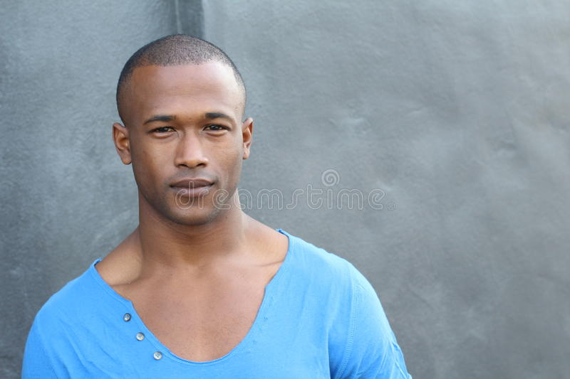 Gorgeous African man with a flawless skin with copy space stock photos