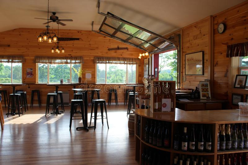 Large airy tasting room with tables and windows for company, Critz Farms & Brewing Company, Cazenovia, New York, 2018 stock photography