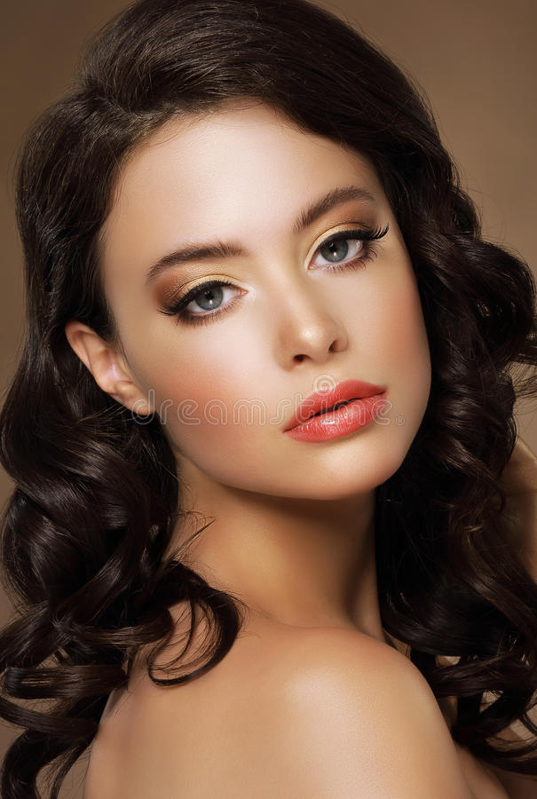 Gorgeous Alluring Lady with Tress and Bronzed Skin. Classy Alluring Lady with Tress and Bronzed Skin royalty free stock photos