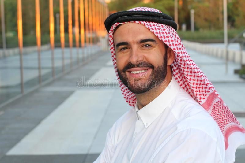 Gorgeous Arabic businessman smiling in office space stock photography