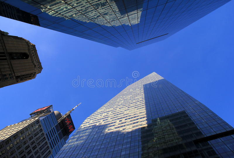 Gorgeous architecture against brilliant blue skies,NYC,2015. Beautiful example of modern architecture near Bryant Park, reaching up towards brilliant blue skies royalty free stock image