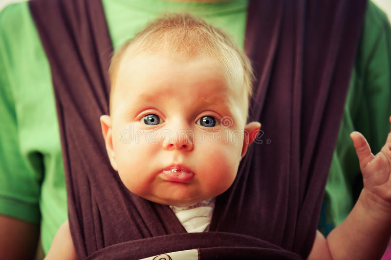 Gorgeous baby looking on camera stock image