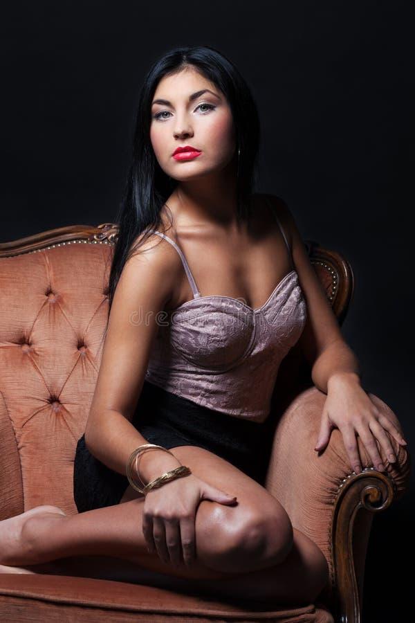 Gorgeous beauty. On a luxury armchair stock photos
