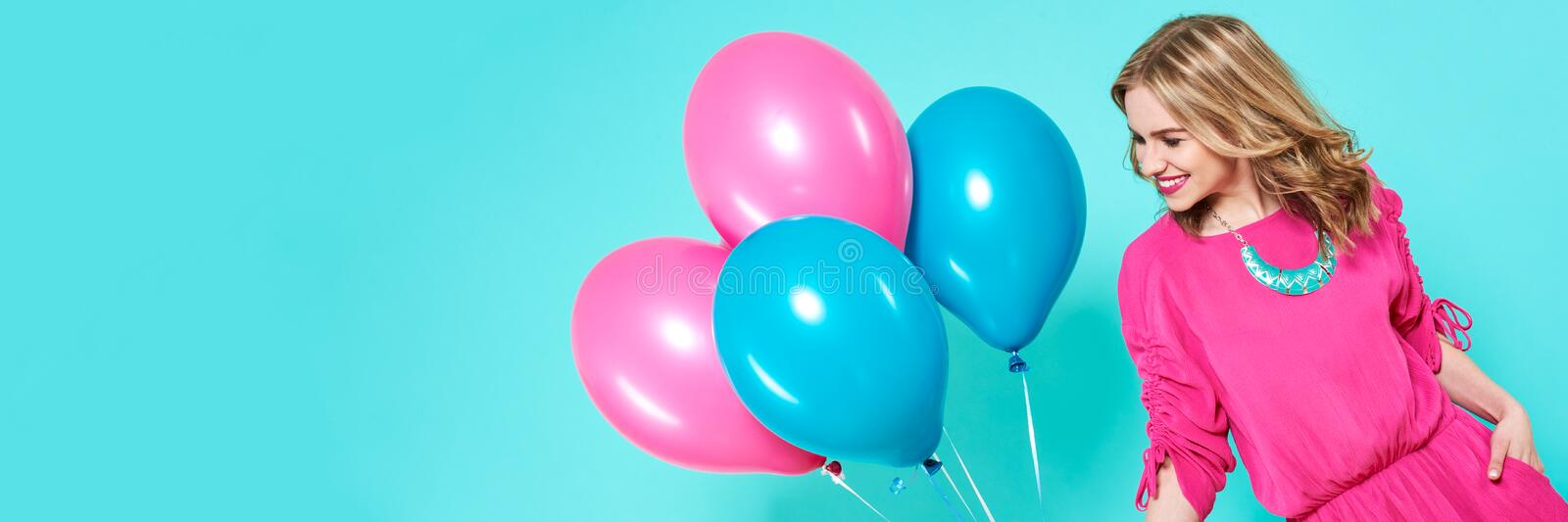 Gorgeous birthday girl in party outfit holding colourful balloons. Attractive trendy teenager celebrating birthday. Party concept. Gorgeous birthday girl in stock images