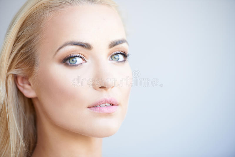 Gorgeous blond woman with beautiful green eyes royalty free stock photos
