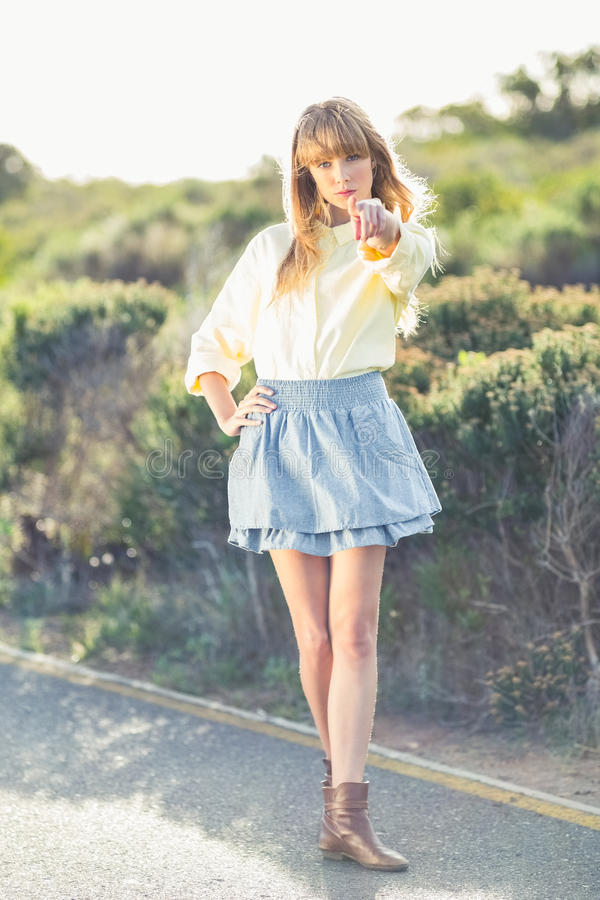 Download Gorgeous Blonde On The Roadside Pointing At Camera Stock Photo - Image of outdoors, stylish: 33278982