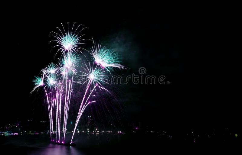 Gorgeous blue and purple fireworks against the night sky with free space royalty free stock images