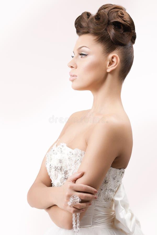 Gorgeous bride in long white luxury dress royalty free stock photos