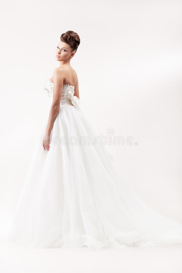 Gorgeous bride in long white luxury dress royalty free stock images