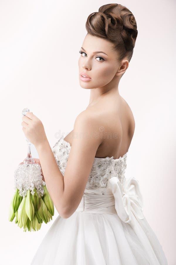 Gorgeous bride in long white luxury dress royalty free stock photo