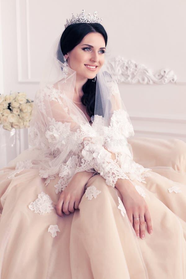 Gorgeous bride in luxurious wedding dress with accessories. Fashion interior photo of gorgeous bride in luxurious wedding dress with accessories stock photos
