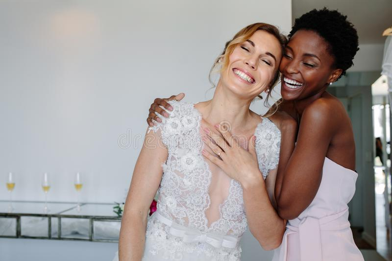 Cheerful bride and bridesmaid on the wedding day royalty free stock photo
