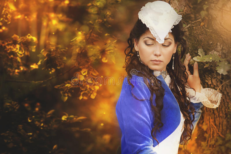 Gorgeous brunette beauty in a old-fashioned dress royalty free stock photos