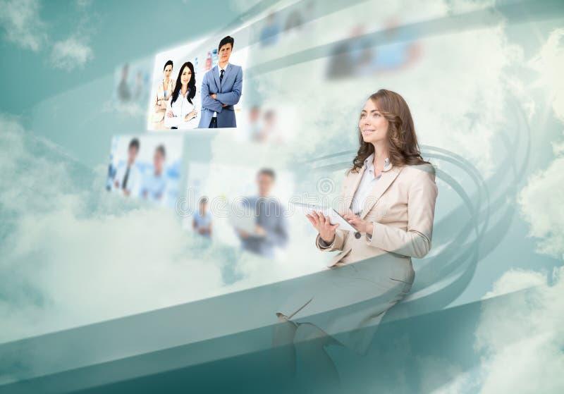 Gorgeous businesswoman using digital interface. While cloud computing stock photo