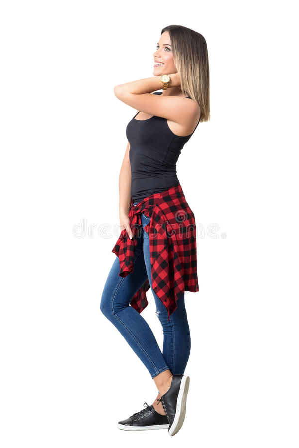 Gorgeous casual stylish woman adjusting hair looking up and smile royalty free stock photos