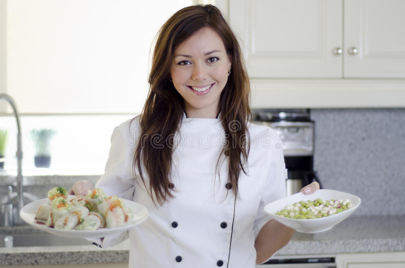 Gorgeous chef loving her job royalty free stock photos