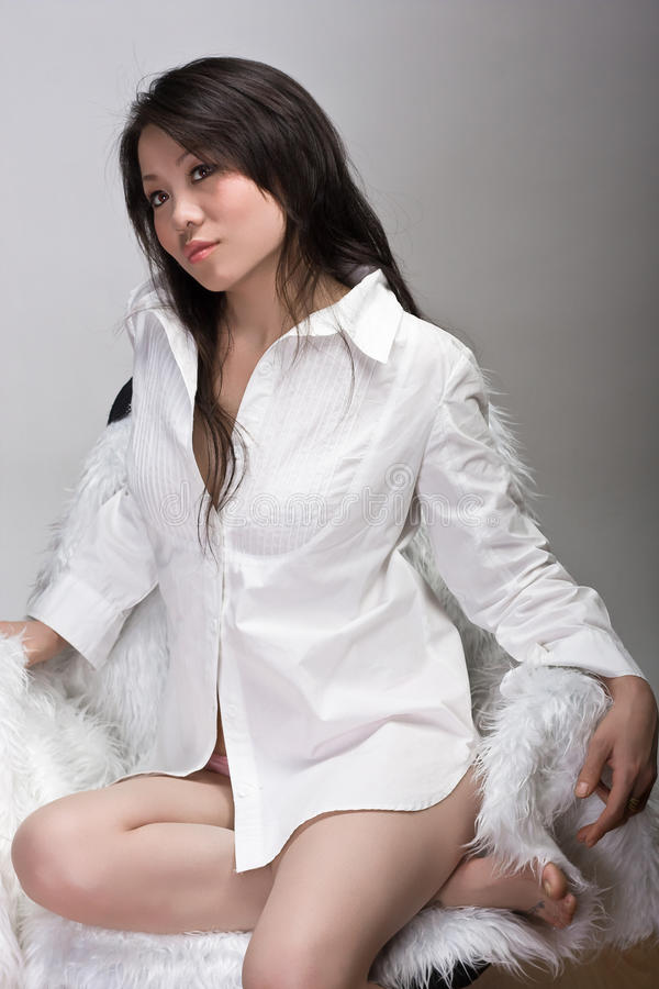 Free Gorgeous Chinese Girl In Chair Stock Photos - 11815443