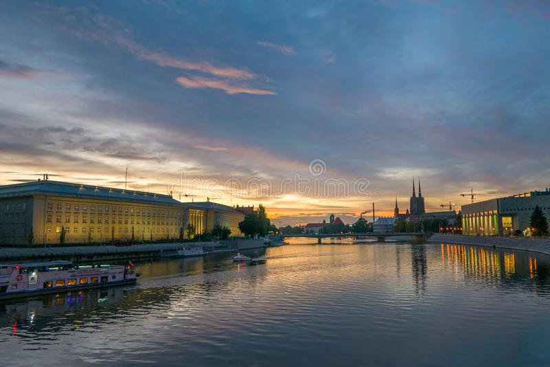 Gorgeous cityscape of Wroclaw during vibrant sunset stock images