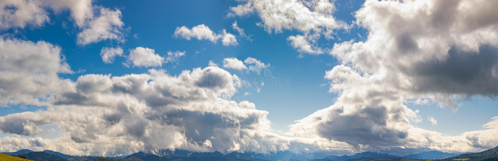 A gorgeous cloudscape above the mountain royalty free stock photos