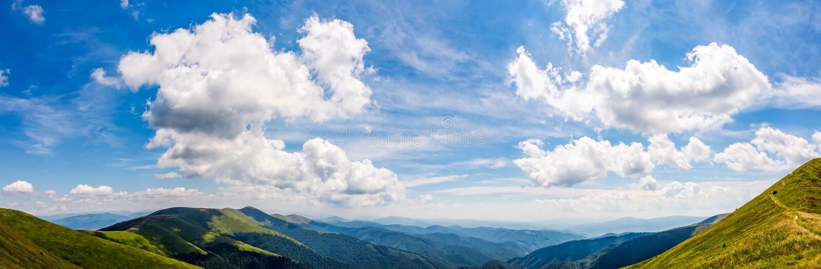 Gorgeous cloudscape over the mountain ridge tops royalty free stock image